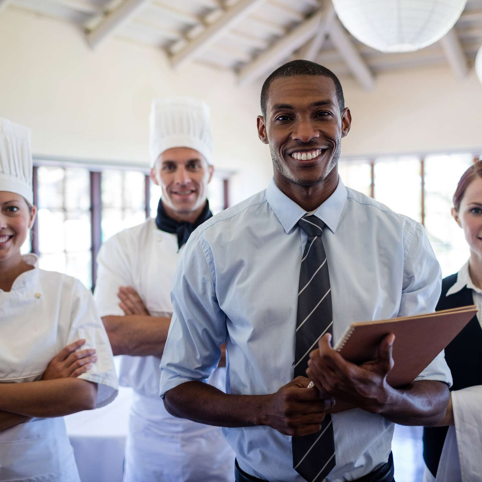 Group of happy hotel staffs standing in hotel